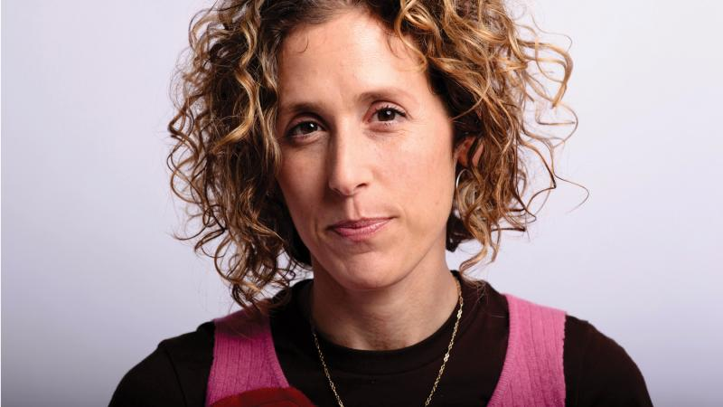Professional photo portrait of Cara Ungar, who has curly hair.