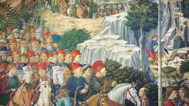 Procession of men and horses on a winding mountain path