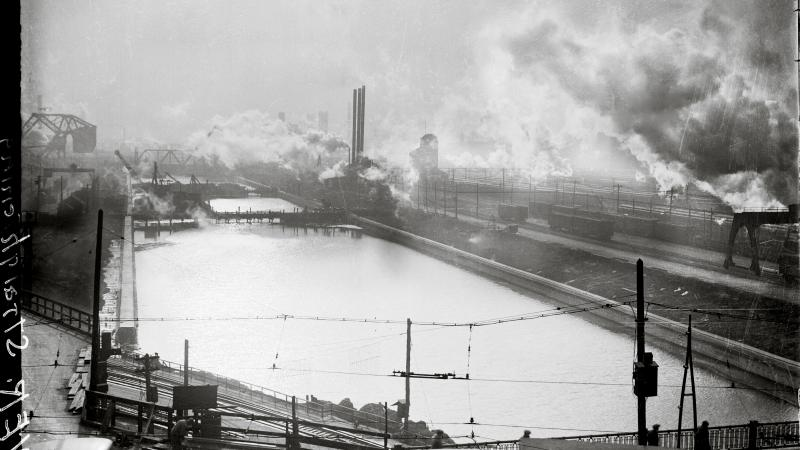 The Chicago River, surrounded by smokestacks, industrial yards and smoke
