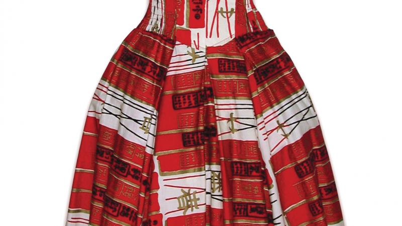 A red dress with a sweetheart neckline and full skirt, patterned with chopsticks and chinese characters