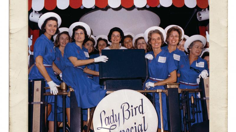 Photograph of women in blue dresses with Lady Bird Johnson