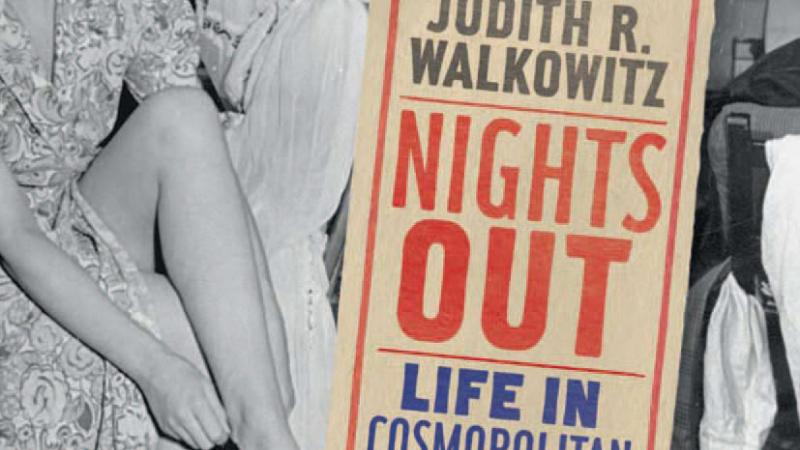 "Photograph of a sign that reads ""Nights Out: Life in Cosmopolitan London"""