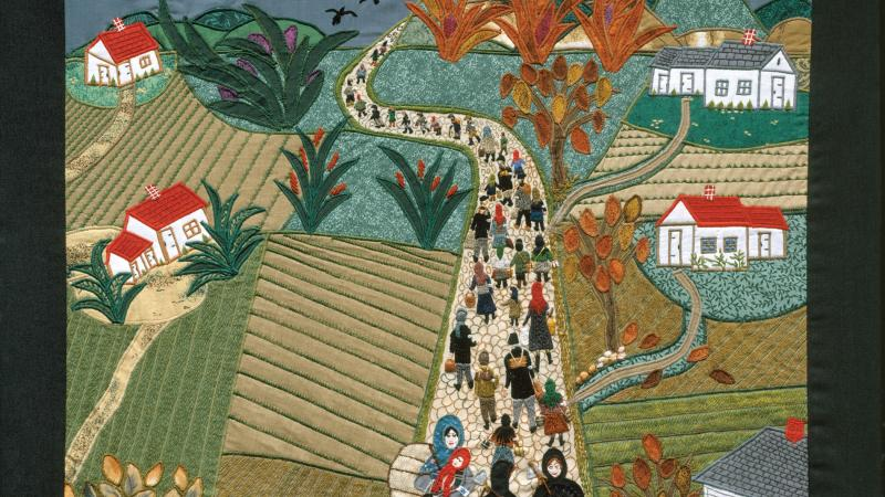 Quilt depicting people leaving a village by a road