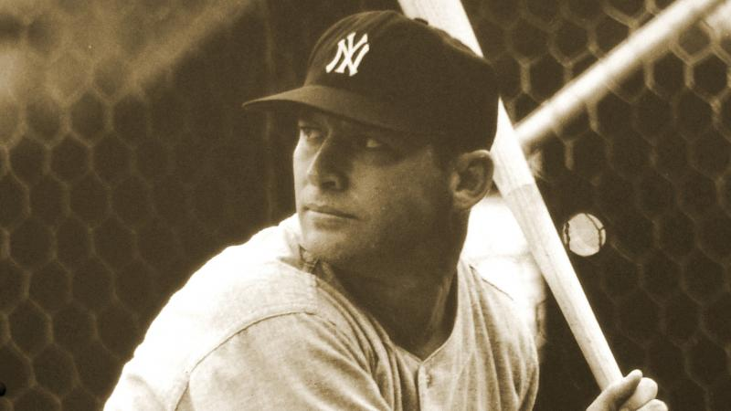 Mantle at bat, ready to swing, wearing a New York Yankees cap