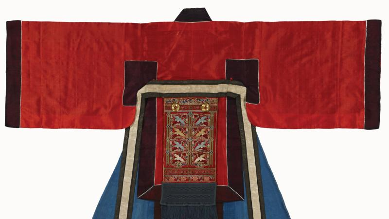 Robe, laid flat, with red sleeves and blue coat, edged with black and embroidered