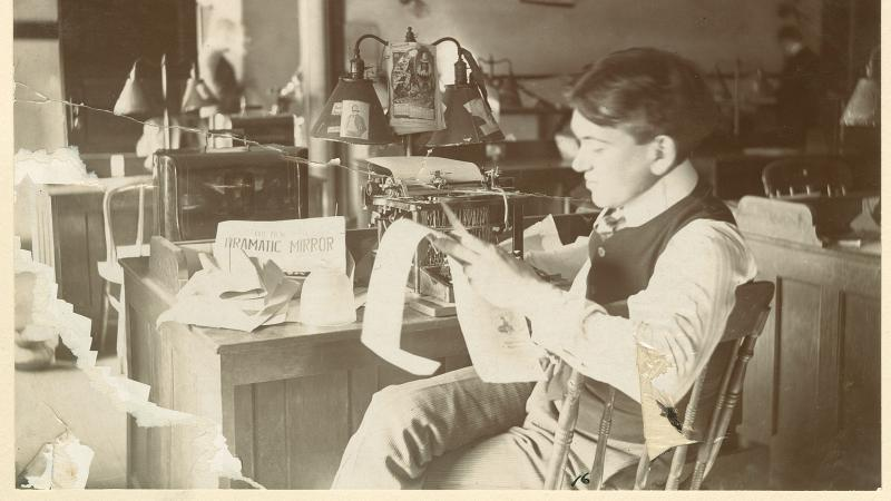 Photograph of H.L. Mencken sitting at his desk at The Baltimore Herald.