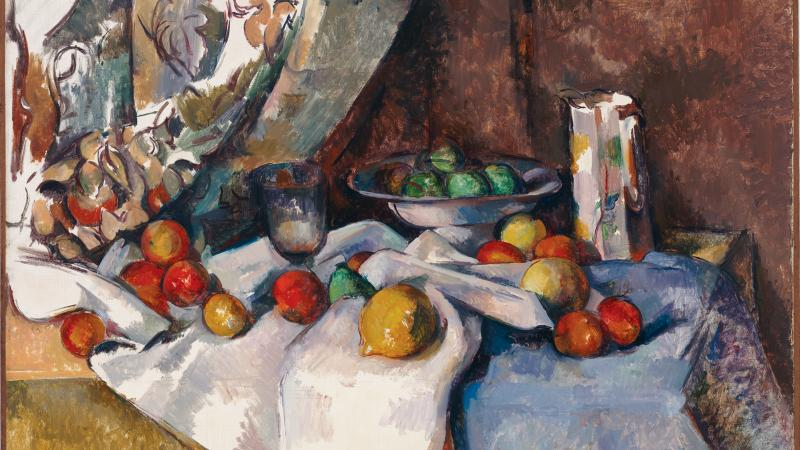 Still-life painting of a variety of fruits (apples, peaches, and others) set out upon a table draped with linens.