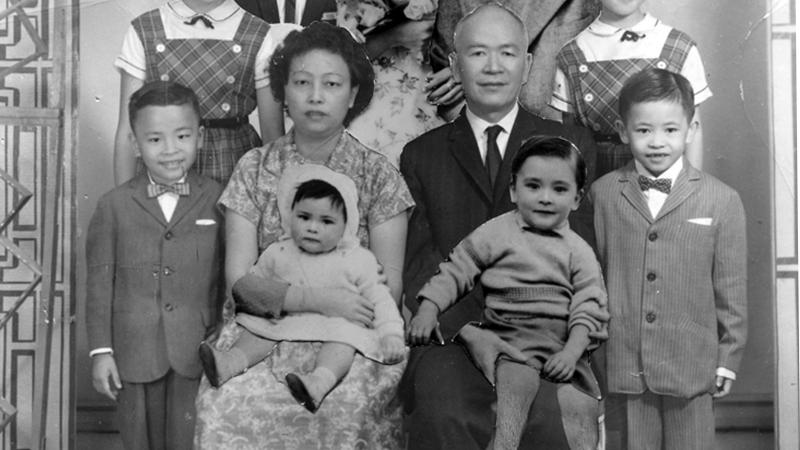 Black and white photo portrait of a Chinese family.