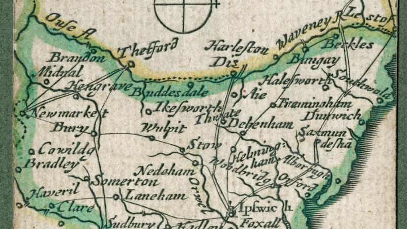 A color pocket map with mostly green outlines over yellowed paper showing the routes and dimensions of Suffolk, England.