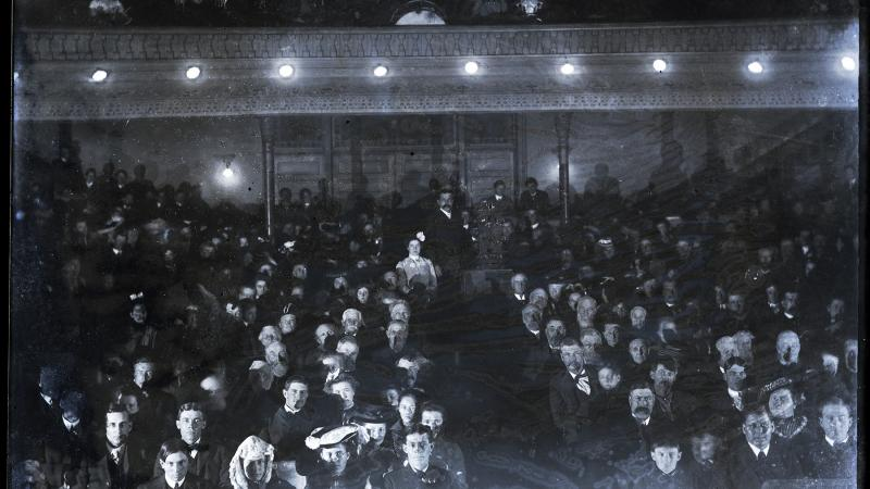 Black and white photo of an early cinema in Iowa, full of viewers.