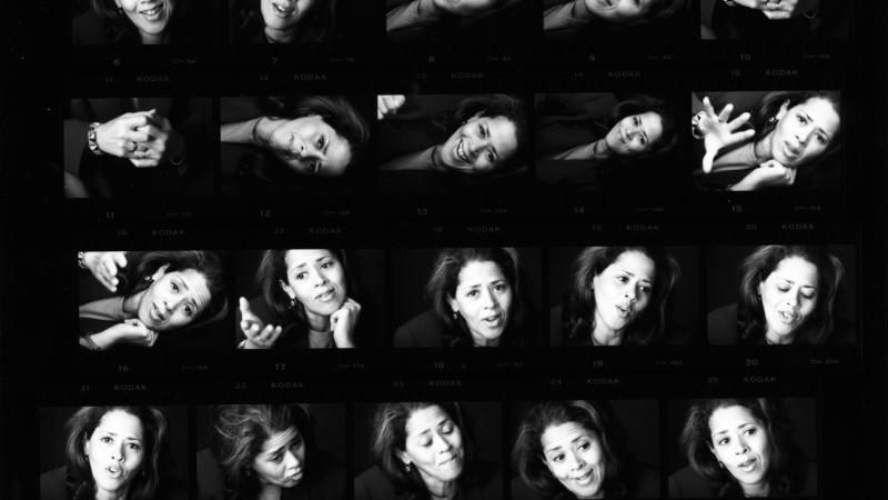 Repeated headshots of Anna Deavere Smith laid out on a black background in artistic fashion.