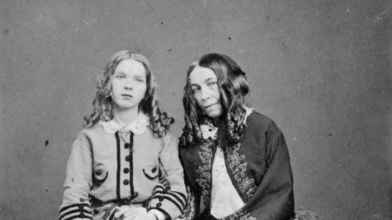 Black and white photo of Elizabeth Barrett Browning with her son, Robert.