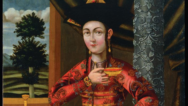 The Young Woman in a Georgian Costume; she is dressed in rich red and gold robes, with heavy gold earrings, holding a golden bowl above her chest
