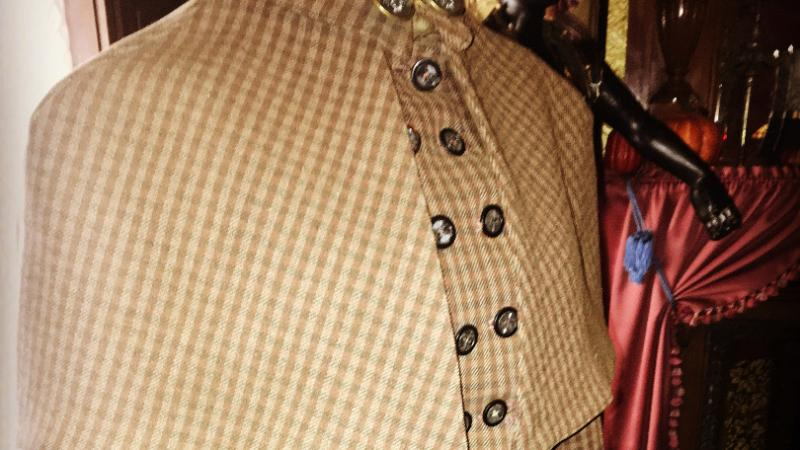 A women's riding coat dated c. 1888.