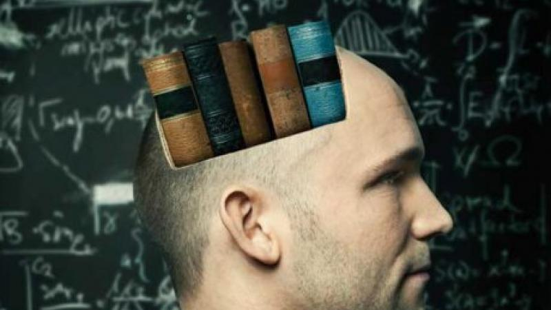 Man in profile with spine-out books superimposed on his head.