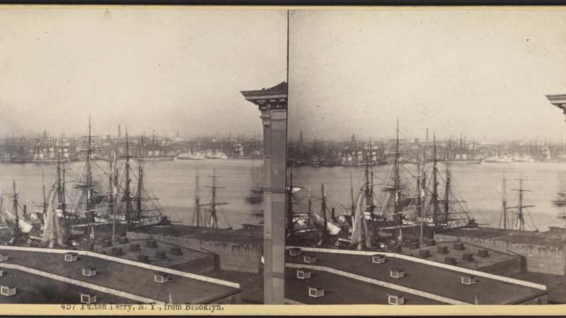Black and white photo of Fulton Ferry, looking over port of boats