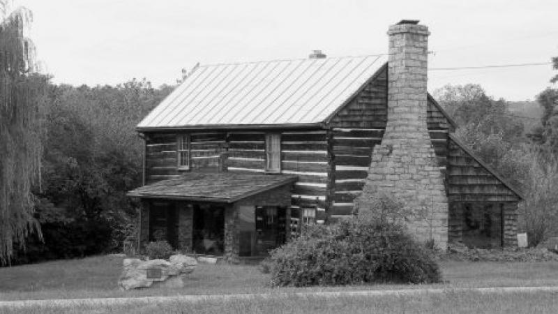black and white photo of a log cabin