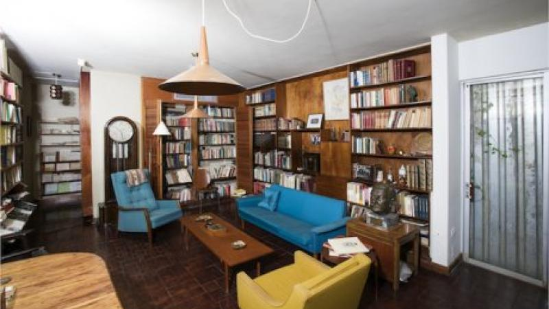 photograph of a library with couches