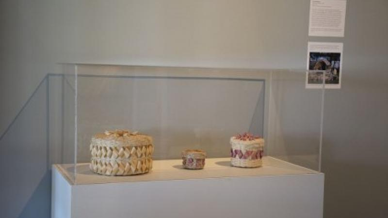 photo of woven baskets in a glass case