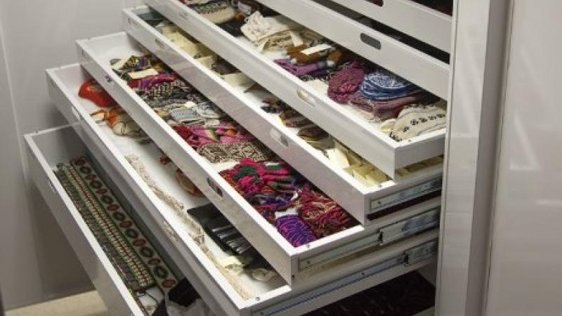photo of open drawers with fabric inside