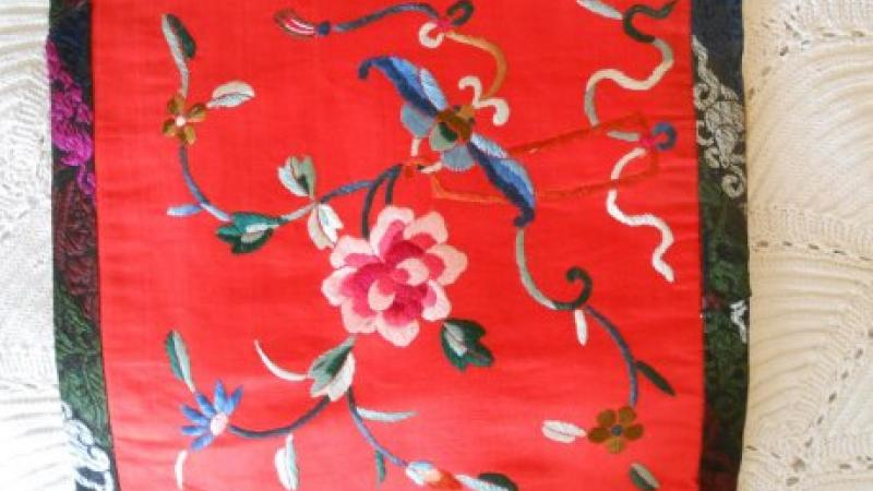 photograph of red embroidered fabric