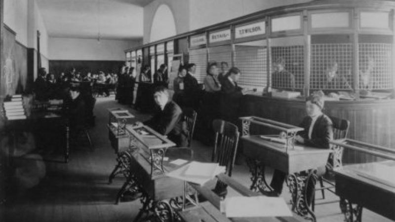 black and white photo of students working at desks