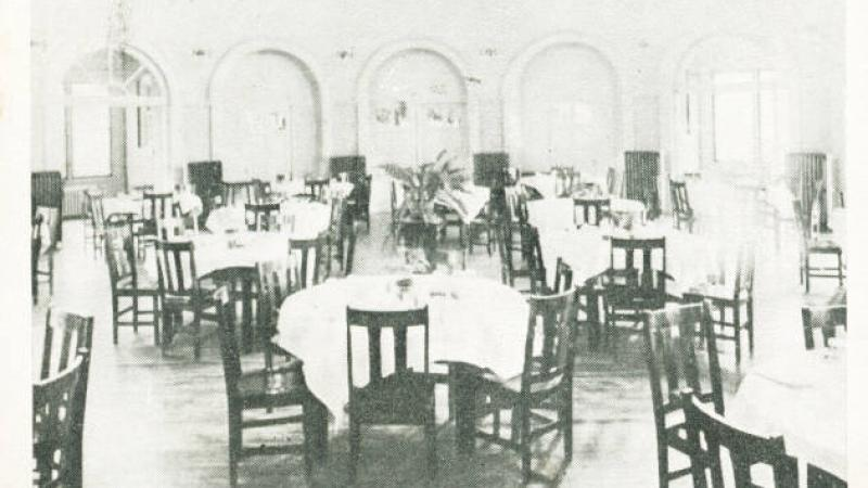 black and white photo of a dining room