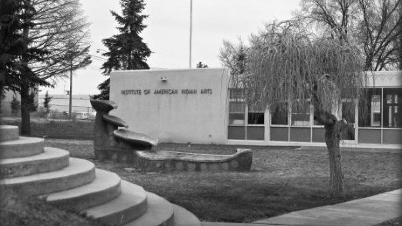 black and white photo of administration building sign