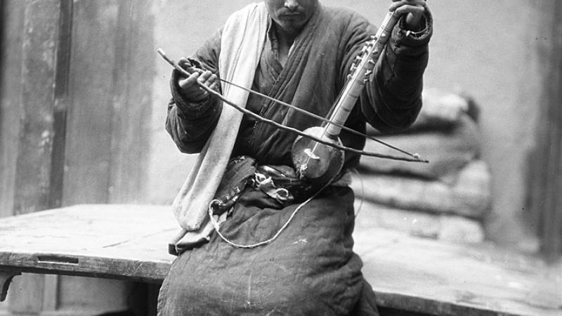 Musician with Instrument, Shache, China, photographed by Helmet De Terra, ca.1928.