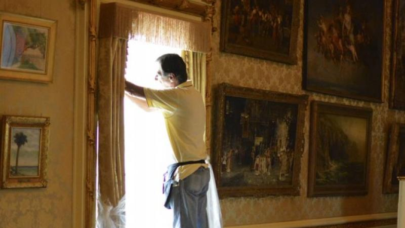 Applying film in Flagler's Music Room
