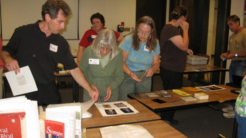 Randy Silverman demonstrating drying techniques for paper-based records and book