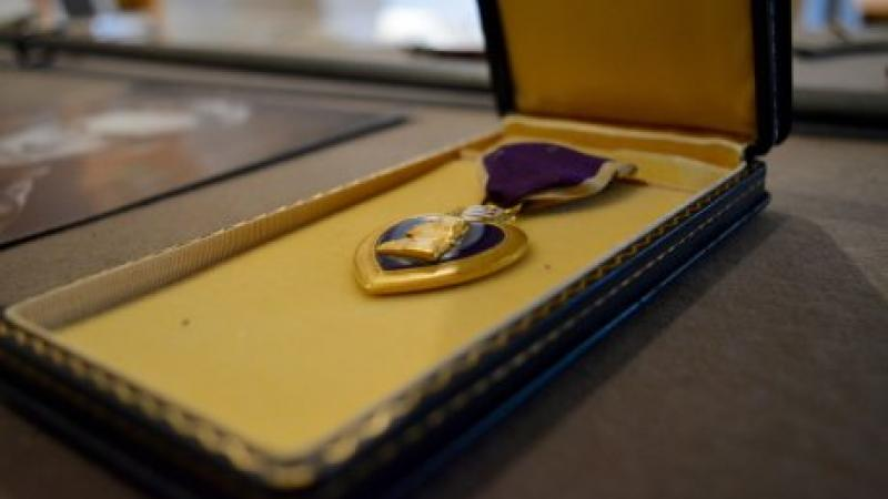 photo of a purple heart medal in an open box