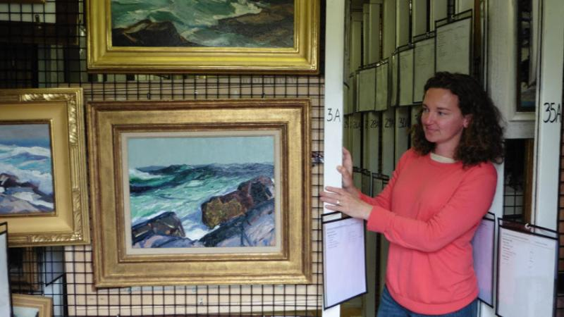 Jennifer Pye, Curator of Collections, showing the custom painting racks.