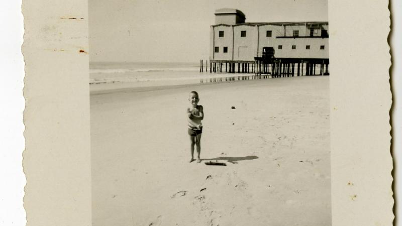Photograph, child on 30th St. beach with Avalon Pier visible in background, 1945