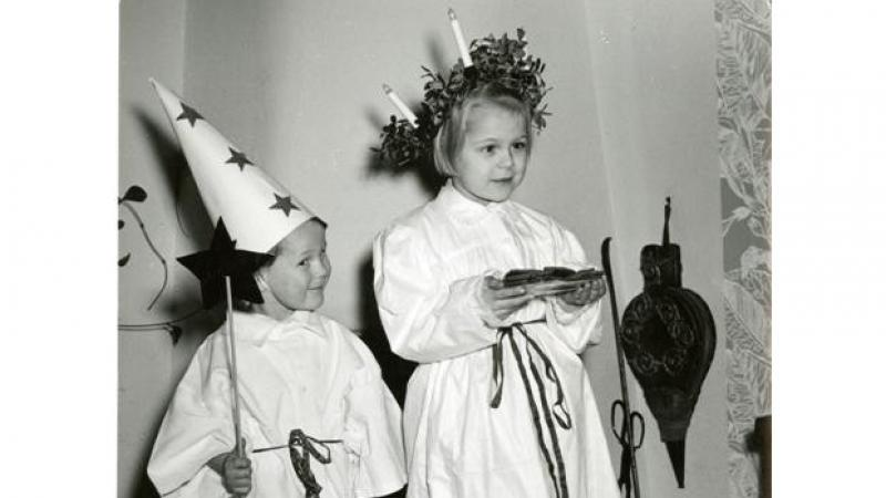 A little girl and a little boy portraying the Swedish tradition of Sankta Lucia.