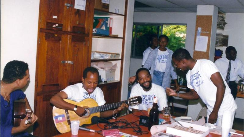 Relaxing in the newsroom on Radio Haiti's sixtieth anniversary, 1995.