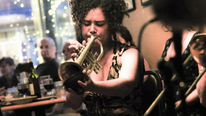 Shaye Cohn of Tuba Skinny with Tupelo the dog at the Rosendale Cafe in New York.