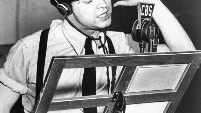 Orson Welles at microphone
