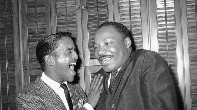 Sammy Davis Jr. in a lighthearted exchange with Martin Luther King Jr.