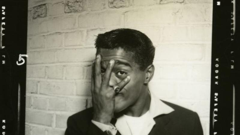 A backstage photo of Sammy Davis Jr. playfully blocking his face with his hand