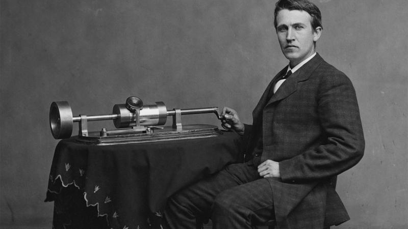 Thomas Edison with phonograph, 1870s.