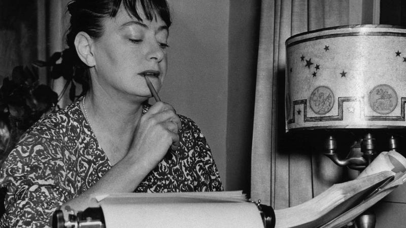 Pensive Dorothy Parker at typewriter
